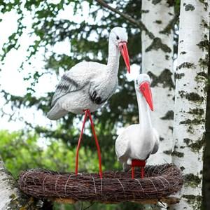 Садовая фигурка гнездо с аистами